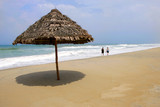Thatched umbrella on deserted beach, Hoi An Vietnam