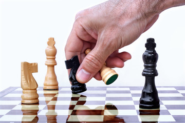 Chess player making his move