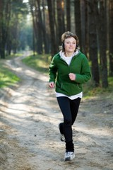 Girl runner in the forest