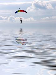 Parachuter landing over the water