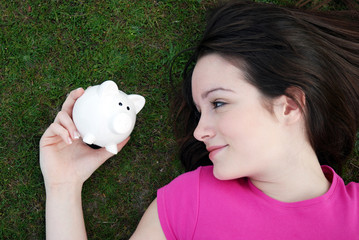 young teenager with piggy bank