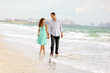 beautiful happy couple walking the beach