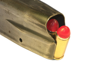 9mm shock rounds in a magazine on white