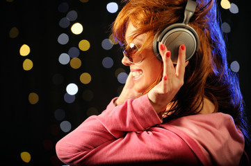 Young redhead woman with headphones