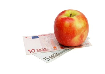 Fresh red and yellow apple on small euro bills isolated