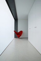 corridor and a red chair