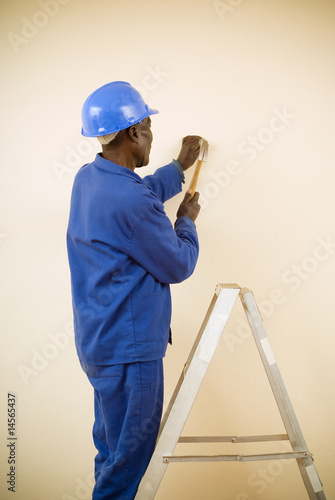 Construction Worker Standing on Ladder