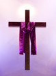 Easter cross with purple sash floating with a glow behind