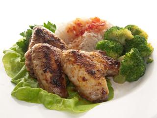Hähnchenflügel mit Reis