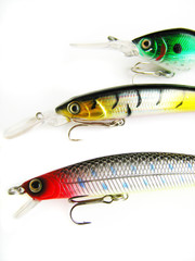 colorful fishing lures on a white background