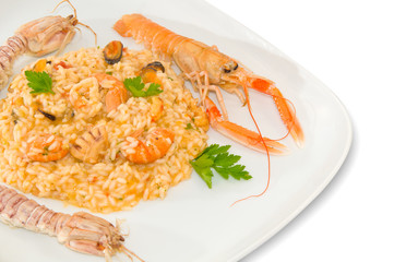 Risotto with cherry tomatoes and seafood. Italian food.