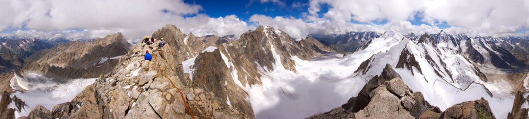 Panorama of Caucasian mountains with climbers at the top - 3