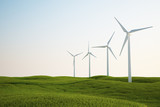 wind turbines on green grass field
