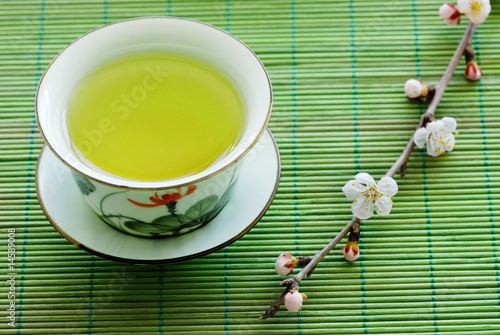 A cup of herbal tea on bamboo straws