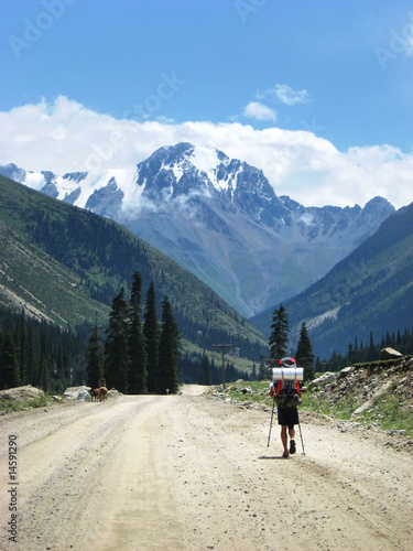 Man with backpack walking in mountain