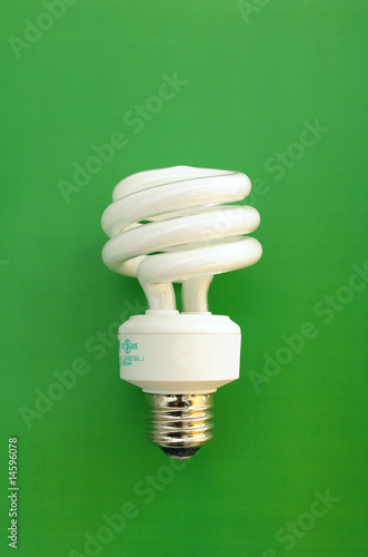 Compact florescent light bulb on green