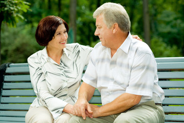 Attractive happy smiling senior couple embracing outdoors