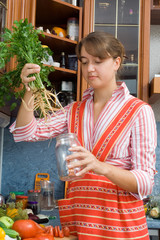 Girl putting parsley in the jar