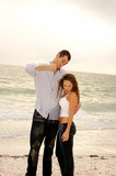 funny tall man pretending to punch short woman poster
