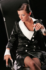 Beautiful business-lady with long white nails looking down
