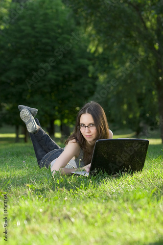 student with laptop outdoors