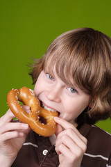Boy eating a soft pretzel