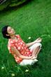 meditating woman in green environment