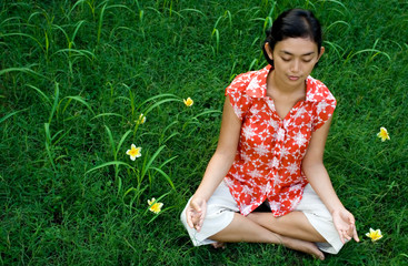 asian woman meditation in nature
