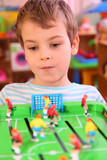 Boy plays in toy football