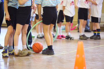 Children's feet in sports hall