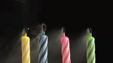 Birthday Candles blowing out, slow motion poster