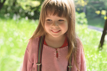 smiling little girl background of nature