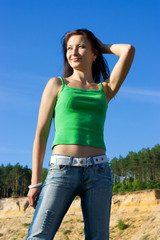 The nice girl in a green vest and jeans