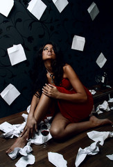 Conceptual photo. Depressive young beauty sitting in a room with