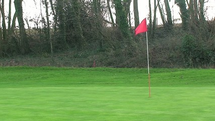 Golf Pole Flag Flapping in the Wind