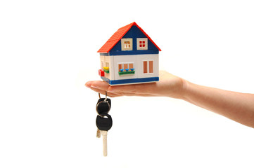 Concept image of a hand holding house keys
