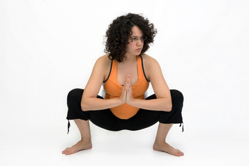 young woman excercising yoga balance