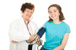 Smiling Doctor and Teen Patient
