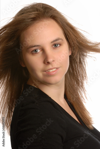 beautiful attractive young woman with hair blowing