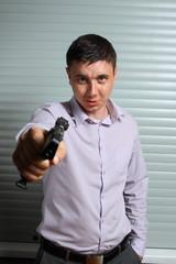 man aiming the gun