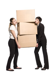 Two women carrying three boxes