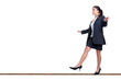 Businesswoman walking a tightrope isolated on white.