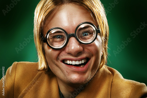 Funny guy grimacing over green background