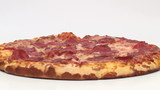 Pepperoni pizza rotates in slow motion - HD