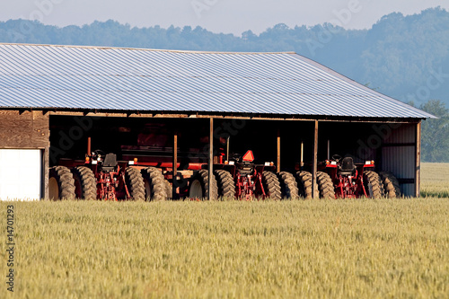 Parked Tractors and Wheat Field