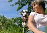 woman  with a Dalmatian outdoors poster