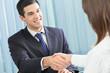 Two happy businesspeople handshaking