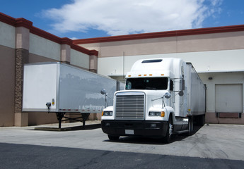 Truck at loading bay of warehouse