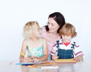 Mother and children doing homework together