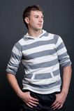 smiley man in stripy pullover poster
